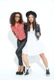 Жизнерадостные девушки представляя на камере Стоковая Фотография RF