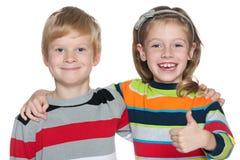 Жизнерадостные дети на белой предпосылке Стоковые Фотографии RF