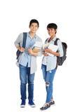 Жизнерадостные одноклассники с рюкзаками стоковое фото rf