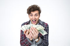 Жизнерадостный молодой человек держа счеты долларов Стоковые Изображения