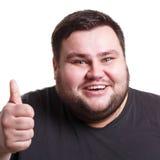 Жизнерадостный тучный человек показывая как, жест большого пальца руки-вверх Стоковые Изображения RF