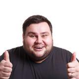 Жизнерадостный тучный человек показывая как, жест большого пальца руки-вверх Стоковое Фото