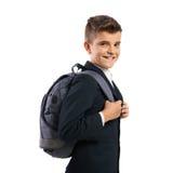 Жизнерадостный школьник с schoolbags Стоковые Изображения
