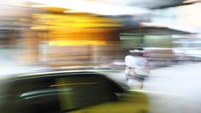 Жизнь нерезкости предпосылки moving в городке Стоковое Изображение RF