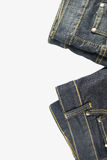 джинсыы предпосылки белые Стоковые Изображения