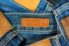 джинсыы предпосылки обозначают кожу Стоковые Фото