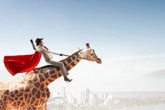 Жираф седловины девушки Мультимедиа Стоковая Фотография