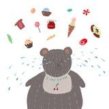 Жирный медведь, который любит съесть помадки стоковые фото