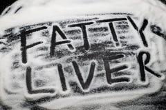 Жировая дистрофия печени слов написанная с и в зернами сахара, сахаром kno Стоковые Фотографии RF