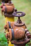 жидкостный огнетушитель ржавый Стоковые Изображения RF