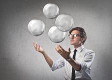 Жонглируя бизнесмен Стоковые Фото
