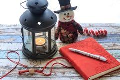 Журнал и с снеговиком и фонарик shinny Стоковое Изображение RF
