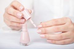 Забота и маникюр ногтя стоковая фотография rf