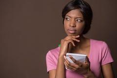 Заботливая молодая элегантная женщина смотря прочь стоковая фотография rf