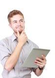 Заботливый портрет бизнесмена используя таблетку стоковое изображение