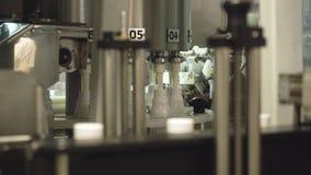 Завалка бутылок с молочными продучтами видеоматериал