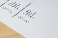 Завершать форму опроса потребителей стоковое изображение