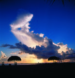 заволакивает заход солнца Стоковые Изображения