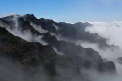 заволакивает кратер Стоковые Фото