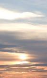 заволакивает померанцовый заход солнца Стоковое Изображение