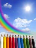 заволакивает солнце радуги crayons принципиальной схемы Стоковое фото RF