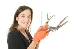 завод садовника рыхлителя оборудует женщину Стоковая Фотография