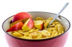 Завтрак с корнфлексами на белой предпосылке Стоковое фото RF