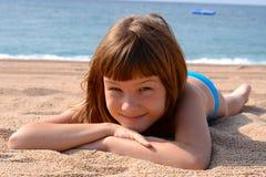 Загорать и плавать для ребенка Стоковые Изображения