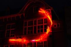 Загоренные коловратки на стене к ноча на Амстердаме освещают фестиваль Стоковое Изображение RF