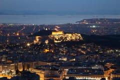 Загоренный акрополь в Афинах, Греции на сумраке Стоковое Фото