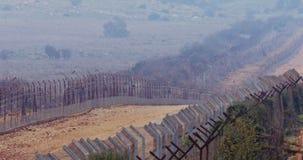 Загородка границы между Израилем и Ливаном колючая проволока и электронная загородка видеоматериал