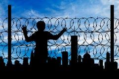 Загородка беженца силуэта Стоковая Фотография
