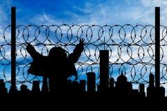 Загородка беженца силуэта Стоковое Изображение RF