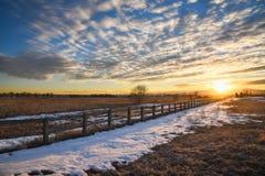 загородка над заходом солнца стоковое фото