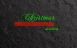 Загрузка рождества написанная в зеленом тексте и красной нагружая Адвокатуре на каменной предпосылке Крутые современные предпосыл стоковые изображения rf