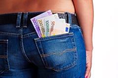 заднее карманн дег джинсыов девушок Стоковое Изображение