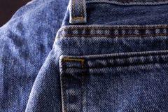 заднее карманн джинсыов джинсовой ткани Стоковое Изображение