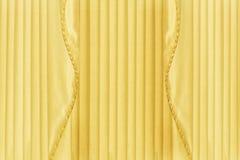 Заднее падение желтых занавесов или задрапировывает Стоковая Фотография