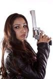 заднее удерживание пушки смотря женщину стоковая фотография rf