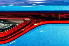 Задние света автомобиля спорт стоковое изображение rf