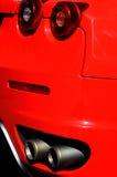 задние спорты красного цвета автомобиля стоковые изображения rf