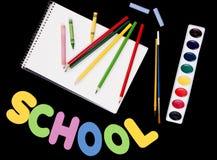 задние черные поставкы школы к Стоковые Изображения RF