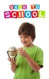 задним изолированная мальчиком тема школы к белизне Стоковая Фотография