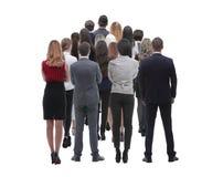 Задняя группа в составе взгляда бизнесмены изолированная белизна вид сзади Изолировано над белой предпосылкой стоковое фото