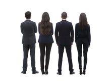 Задняя группа в составе взгляда бизнесмены изолированная белизна вид сзади Изолировано над белой предпосылкой стоковая фотография