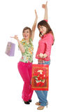 задняя часть приходит покупка 2 девушки счастливая Стоковое Изображение