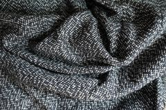 Задрапированная ткань одежды из твида соли и перца Стоковое Фото