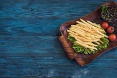 Зажаренная картошка на плите Стоковое Изображение