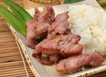 Зажаренная свинина с липким рисом, Тайской кухней стоковое изображение rf