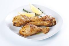 зажаренные в духовке ноги цыпленка стоковая фотография rf